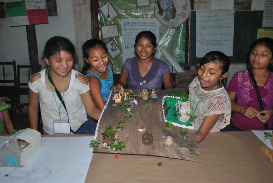 5.Done! One group places down their model for the group exhibit. Photo by Frances Kvietok Dueñas.