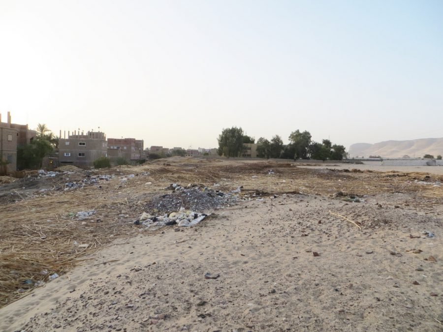 The shena production area looking east towards an elementary school, which now separates the shena from the town-site of Wah-sut. Photo by Paul Verhelst.