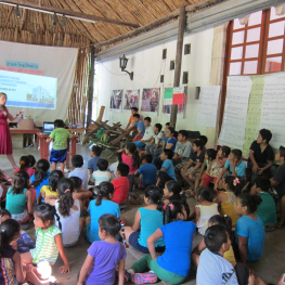 Kasey giving a talk to the students at the museum summer program about the colonial houses in Tihosuco, focusing on how to identify them and learn more about them.  Photo by Socorro Poot Dzib.