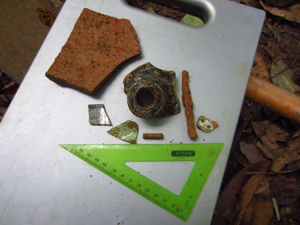 A sampling of artifacts found in one STP at the first site: ceramic, glass, a pipe stem fragment, and a nail. Photo by Megan Postemski.