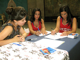 Sixers dancers writing Chinese