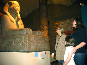 Visitors look up to the Museum's massive sphinx.