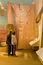 Akhenaten looms over two visitors to Amarna: Ancient Egypt's Place in the Sun.