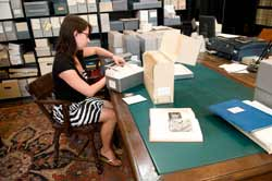 Rhea May, an undergraduate research intern, arranges images from the Museum's work in Kourion, Cyprus.