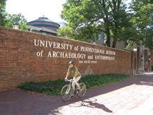 Bike rider in front of the Penn Museum