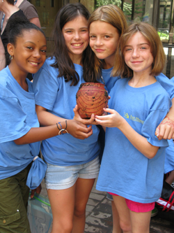 Campers show a pot they unearthed.