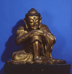 """Seated Shakyamuni, Northern China, Yuan Dynasty (1271-1368 AD), Dry Lacquer, Gilded Wood, H. 81 cm, Penn Museum Object 150417. Sakyamuni, the historical Budda, lived between 563 and 483 BC.  He is seen here seated in meditation. The dry lacquer technique was first used in China during the Six Dynasties period (220 -581 AD). It was later received in the 14th century under the influence of Li Yuan, a Chinese sculptor who studied in Nepal. Layers of cloth soaked in lacquer were built up over a temporary clay one to create a durable yet lightweight hollow image which could be easily carried in procession.  Sacred items were often placed in the interior cavities of Buddha images to increase the potency of the image. Five Buddhist sutras, or texts, were found inside this image, four in Chinese and one in Tibetan."