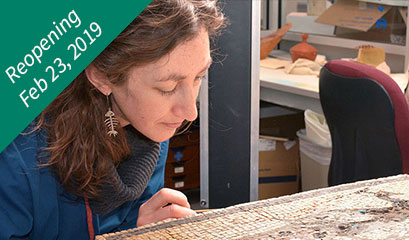 Conservator working with object