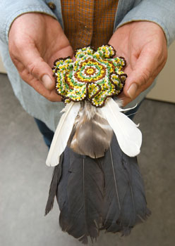A Lenape fan made of beads, deerskin and feathers rests in the hands of Shelley DePaul, Director of the Language Program for the Lenape Nation of Pennsylvania and a co-curator of the new exhibition Fulfilling a Prophecy: the Past and Present of the Lenape in Pennsylvania. Photo by Lauren Hansen-Flaschen.