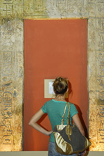 A visitor to the Lower Egyptian gallery pauses in front of  a doorway from the palace of King Merenptah at Memphis