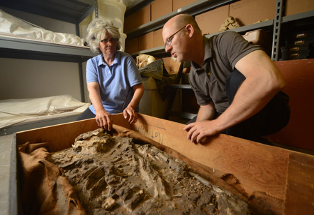 Drs. Janet Monge and William Hafford investigate the 6,500-year-old skeleton.