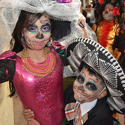 Kids in face painting for Day of Dead