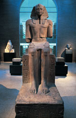 Seated limestone statue of Ramses II from Herakleopolis (Ihnasya el-Medina), Egypt (Dynasty 19, ca. 1250 BCE). Featured in the Upper Egyptian Gallery at the University of Pennsylvania Museum of Archaeology and Anthropology, this statue of Ramses II is a fine example of the recarving of royal sculpture. The disproportionately small head indicates the reworking of an earlier piece, probably dating to the 13th Dynasty. Royal sculptors would have resculpted the head in the official image of Ramses II. Photo: Dr. David Silverman.