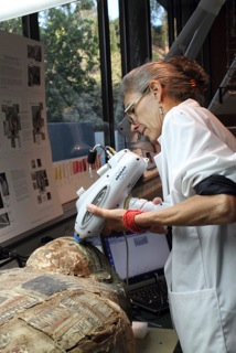 Casey analyzing the surface of the child sarcophagus using a portable XRF analyzer