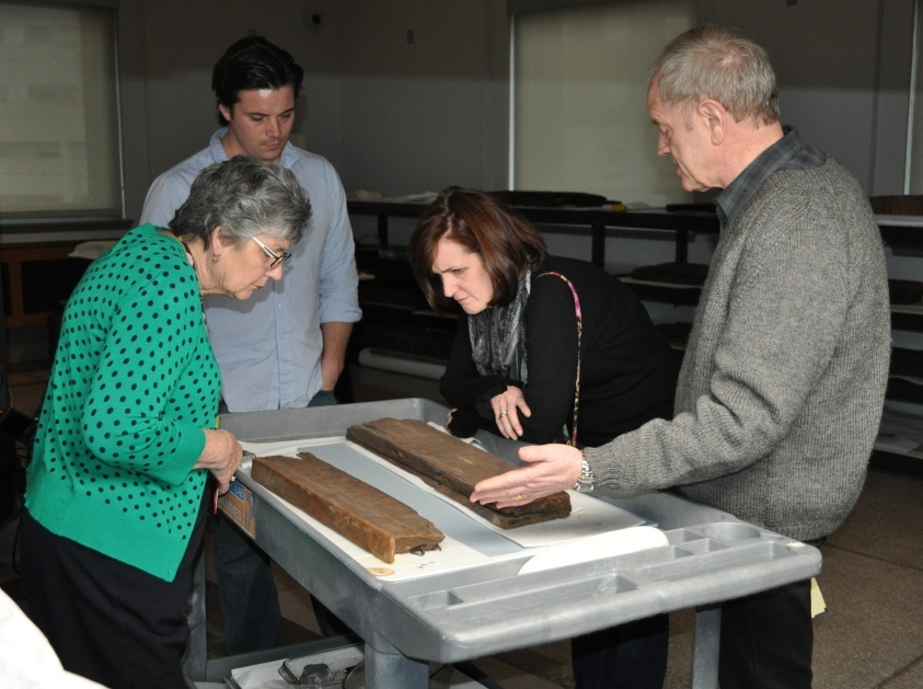 "Examination of one of the canopic box pieces and the ""mystery"" board underway"