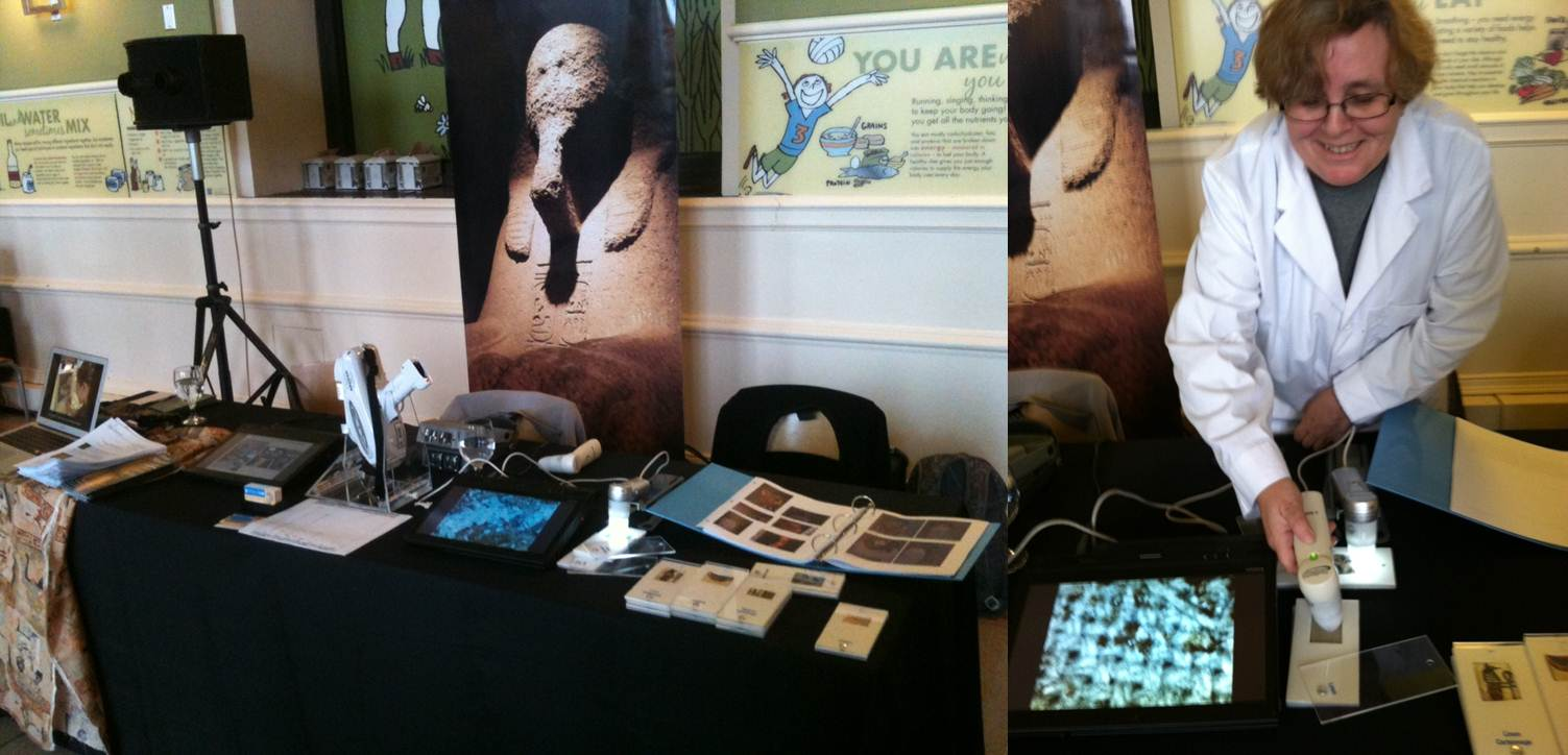 Our table at the Science Festival Press Preview night, featuring our portable XRF analyzer and a Proscope. At right, Lynn demos the Proscope, magnifying a piece of linen at 50X.