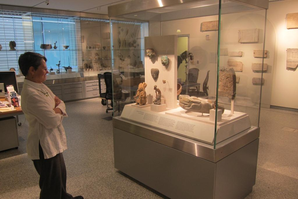 Julie Lawson admires artifacts in one of the cases in the Johns Hopkins Archaeological Museum
