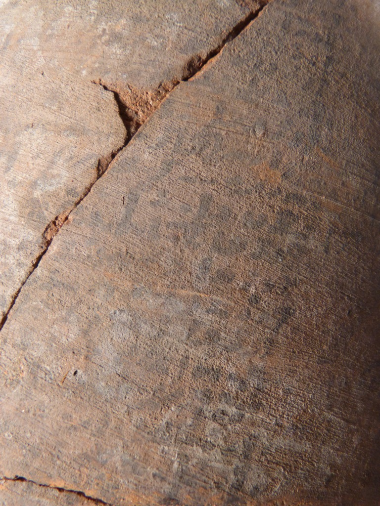 Detail of the black inscription covering the jar.
