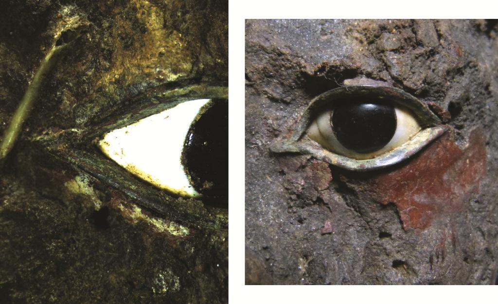 E17910 – Detail of the red paint above and under  left eye and red paint below the right eye (x 10 magnification).