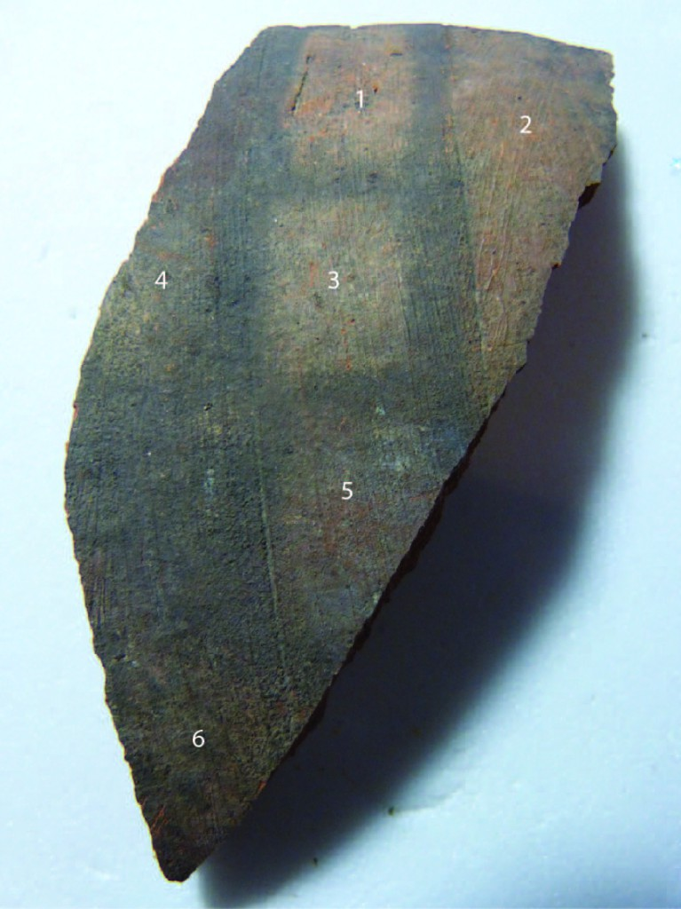 Image showing cleaning tests on a fragment of the jar.