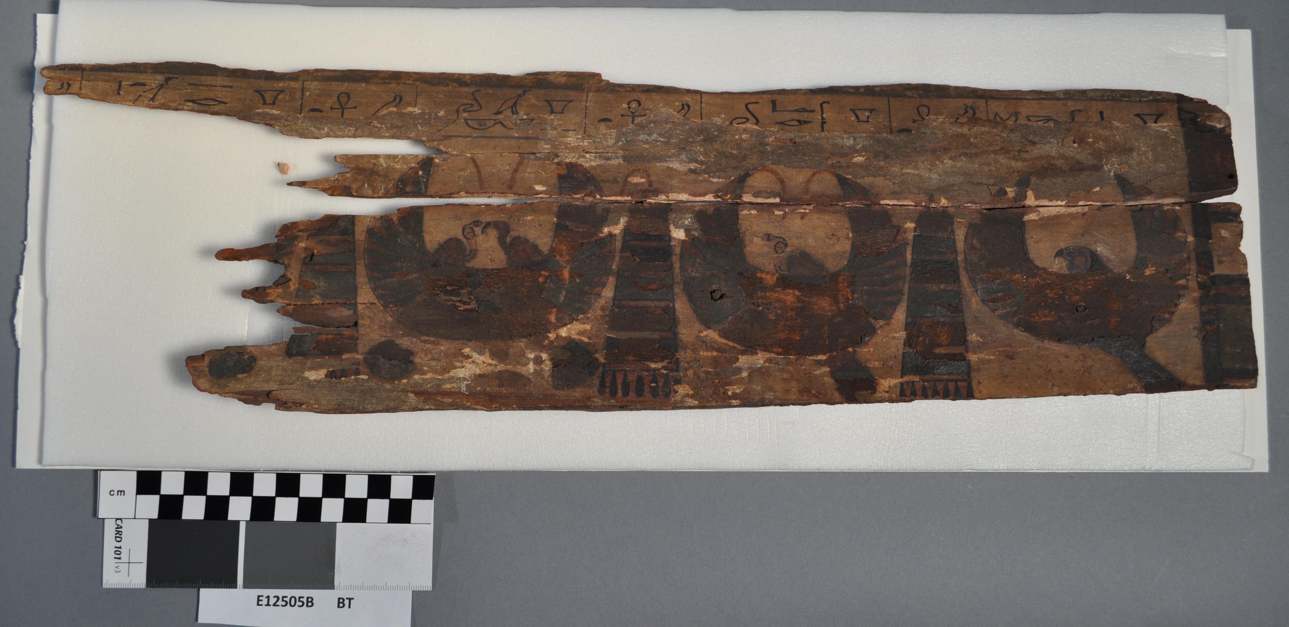This fragment features 3 usekh collars, which were often reserved for nobility. Beside each collar is a mankhet, or counterpoise. The hieroglyphs above are the names of each of the collars, which are slightly different.