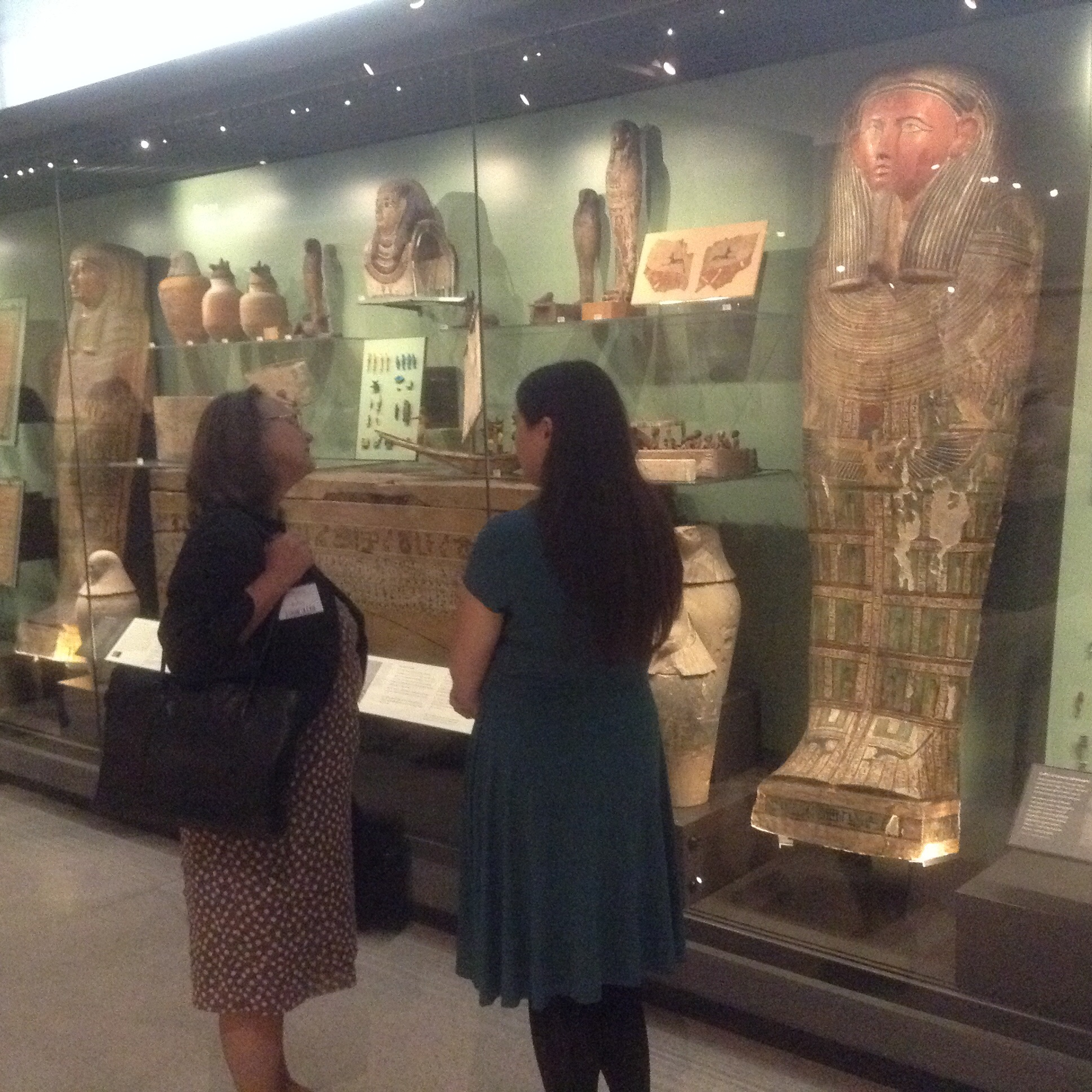 "Bronwen Roberts discusses the treatment on the large ""green coffin"" lid she treated to enable its display (coffin on far right)"