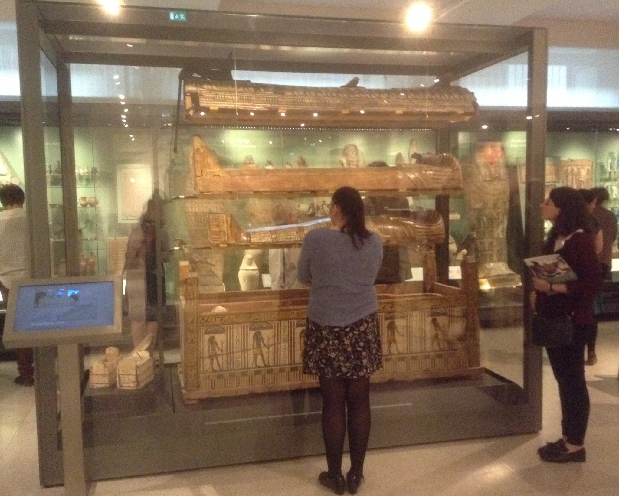 Conference attendees admire the stacked coffins of Djeddjehutyiuefankh (Third Intermediate Period)