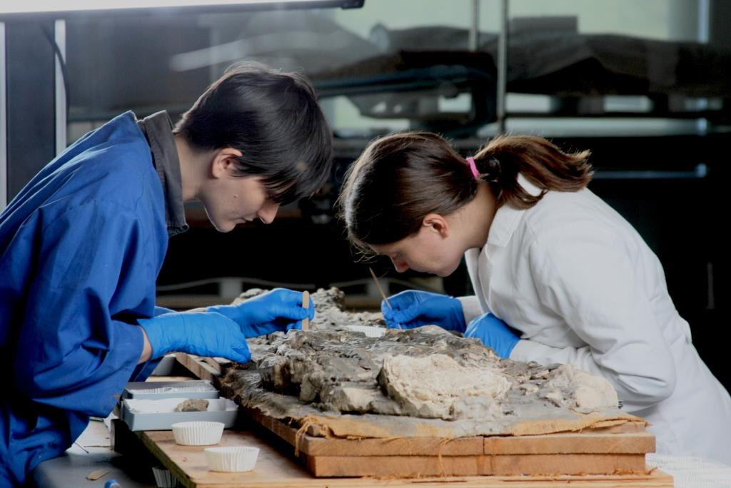 Another shot of Nina and Tessa working on cleaning, mending, and consolidating the fragile remains