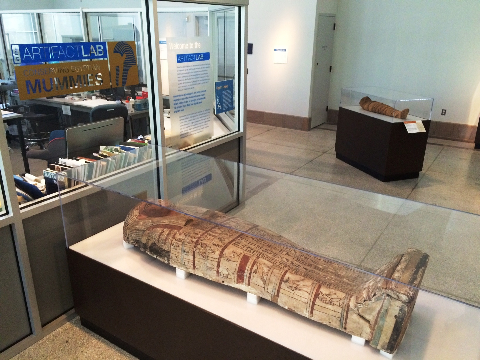 Tawahibre's coffin lid on display at the entrance to the Artifact Lab