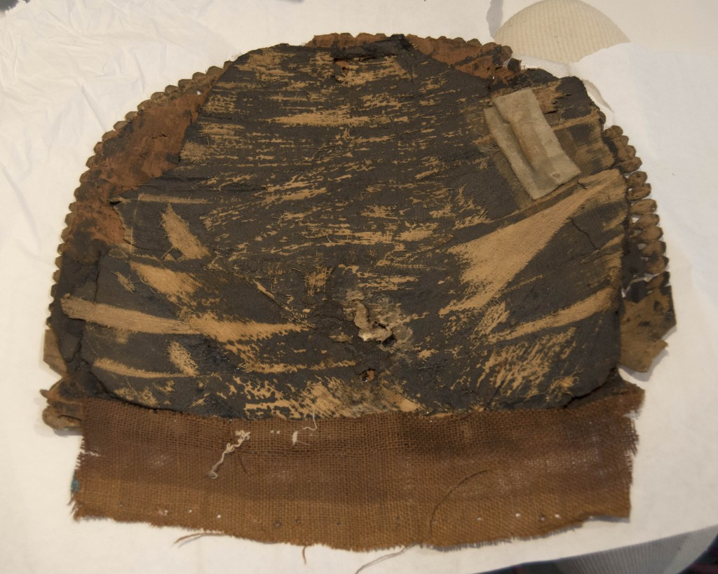 View of the reverse of the cartonnage chest piece, after removal from the mount.