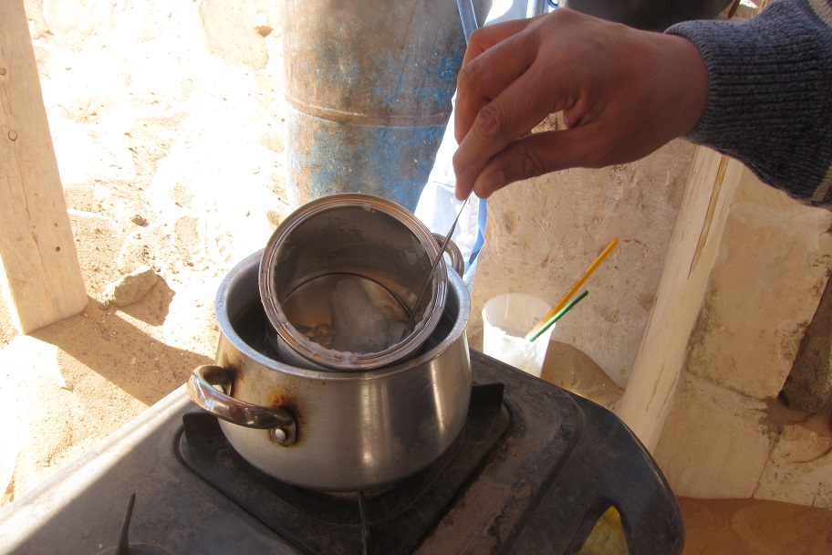 Heating the cyclododecane over a small portable stove on site