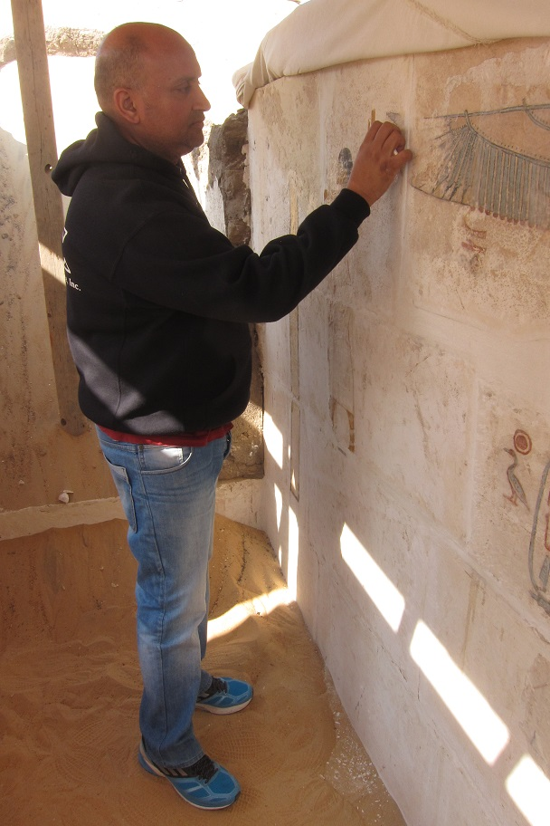Egyptian conservation inspector working in King Senebkay's burial chamber
