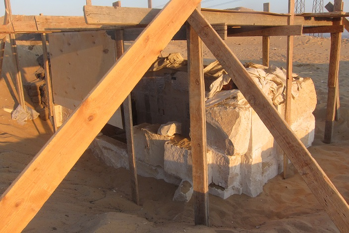 View of the exposed burial chamber with temporary wooden structure on day 1 of the conservation project