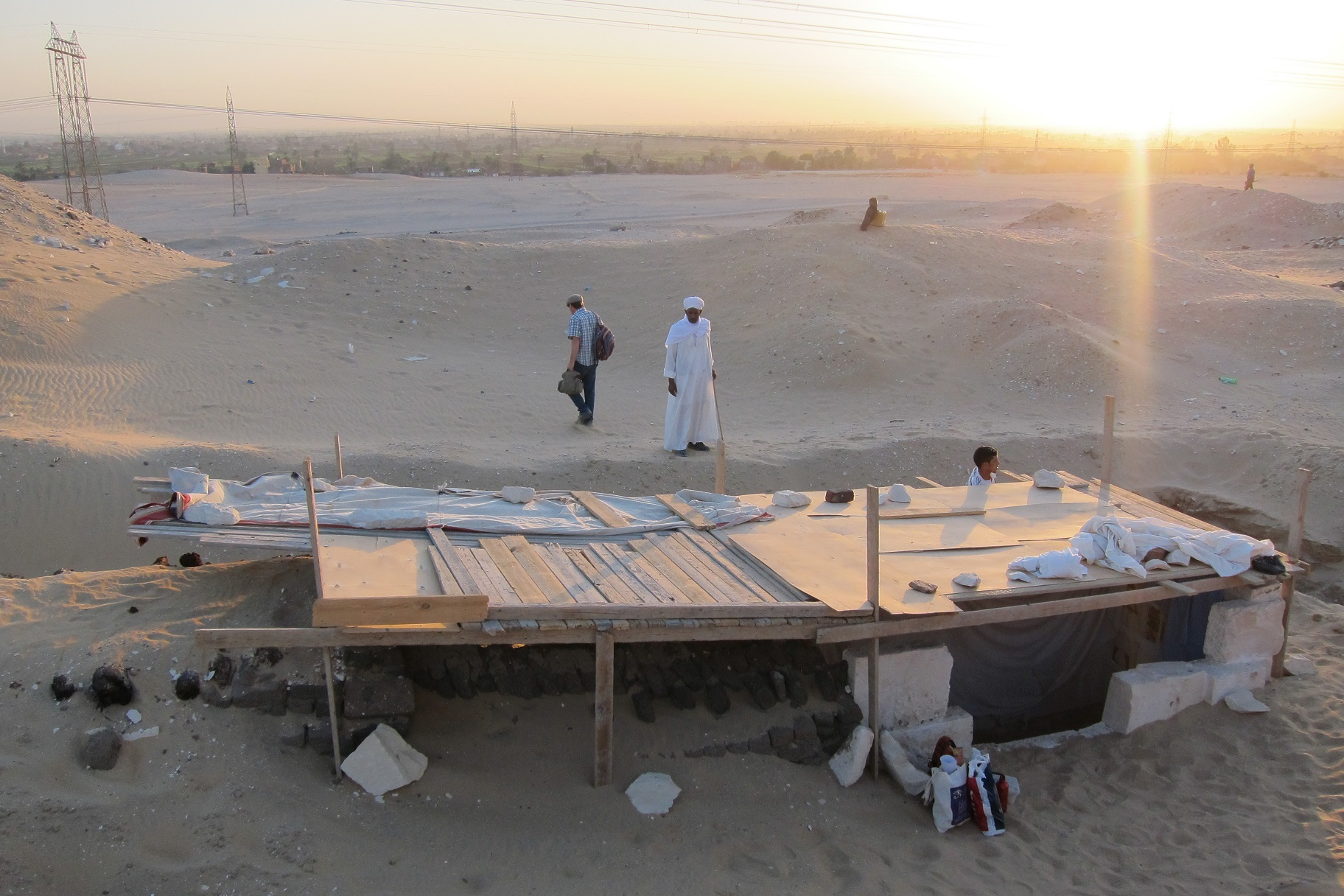A view of the site in South Abydos, with Senebkay's burial chamber covered with a temporary shelter in the foreground