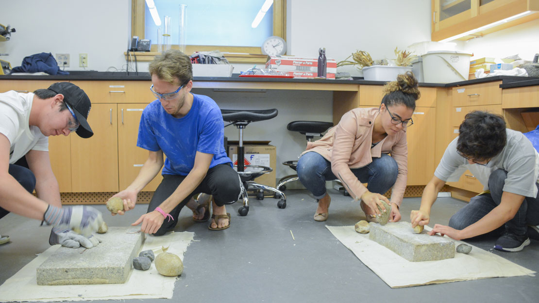Students performing a lab in CAAM.