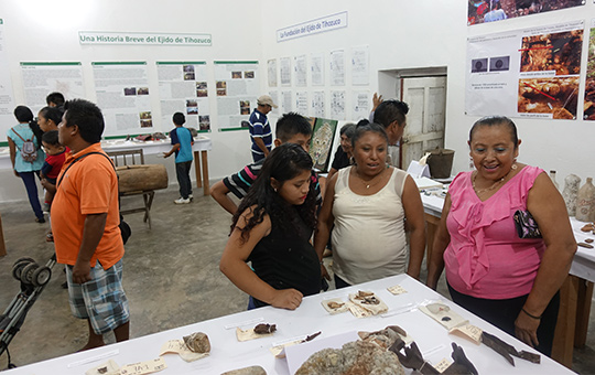 A family examining artifacts in a museum.