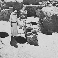 Photo of men standing by cellar holes.