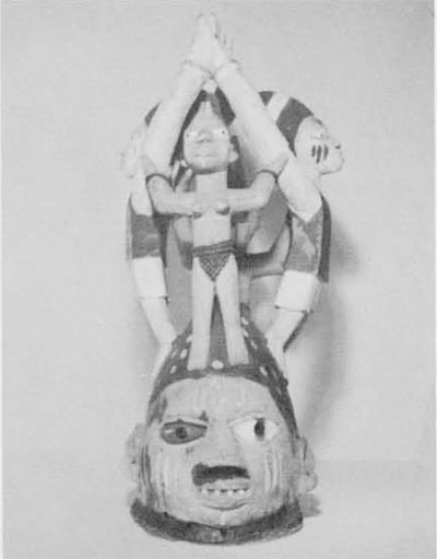 (8) A dance mask of recent manufacture, from the United States National Museum of the Smithsonian Institution.
