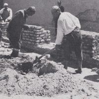 People laying brickwork.