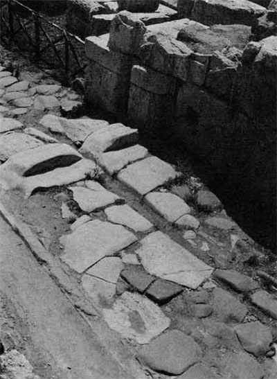 Ruts worn in the paving of the ancient road to Tusculum and Labici where it passed under the arches of the aqueduct at the Porta Praenestina, the modern Porta Maggiore.