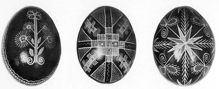 Ukranian Easter Eggs. (Left) New Style floral design from the Poltawa region of Eastern Ukraine. (Center) Pre-Christian design for God of the Sun, copied from the clay eggs found in the tombs. (Right) Folk design from the region of Lwow (Lembergh), WEstern Ukraine, made by Maria Hawrych.