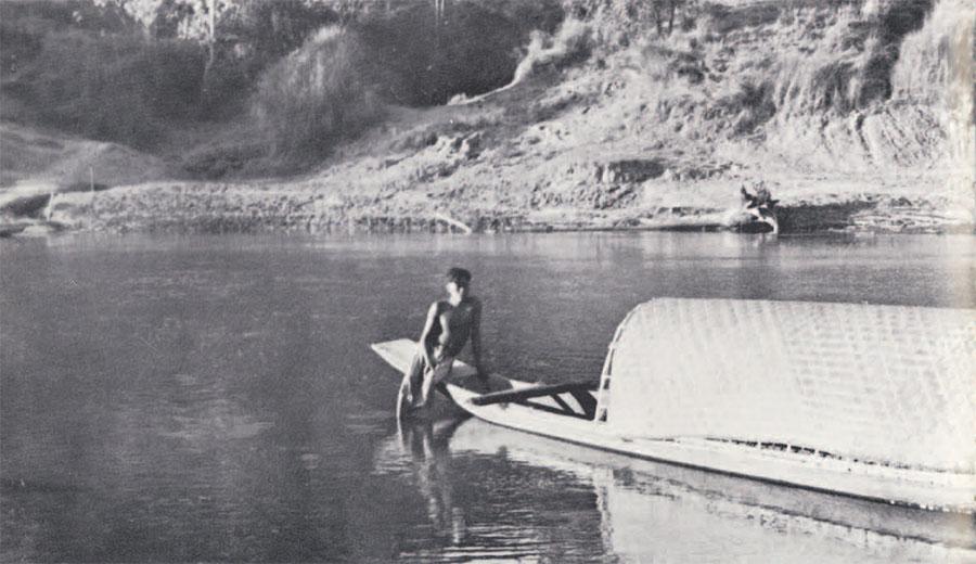 Photo of boy sitting on boat