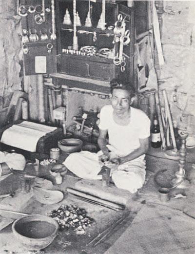 photo of man making jewelry