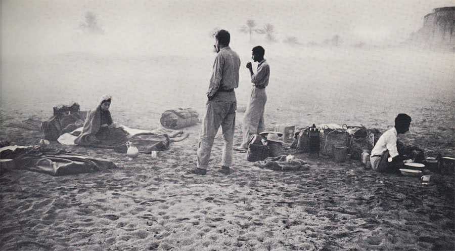 Photo of people eating on a beach
