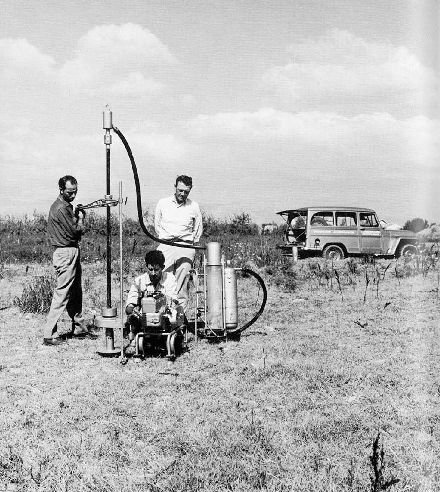 Photo of men using instruments.