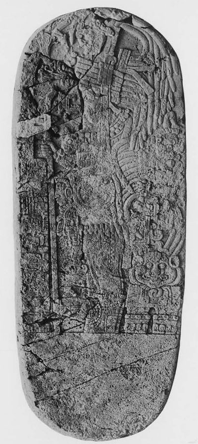"""Stela 20, Tikal. In comparing this with the """"miniature stela"""" we should note the figure, also in profile facing the observer's left, wearing a headdress and holding a staff, as does the figure on the """"miniature,"""" but we should note the dissimilarity of the shape between the two objects."""