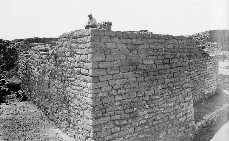 Photo of man sitting on the wall