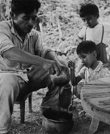Photo of man making candles with children