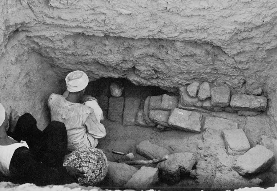 Photo of people in tomb.