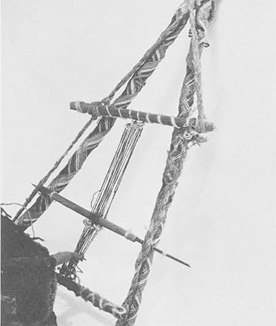 A close-up of the loom and the apparently unique A-frame on which it is mounted. From upper to lower bar the loom is 5 &frac12 inches long.
